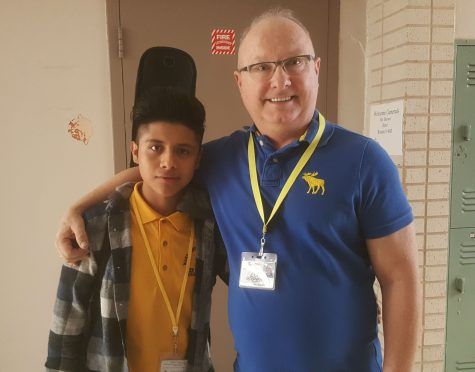 Yelson Algua and band teacher Mr. Brown.