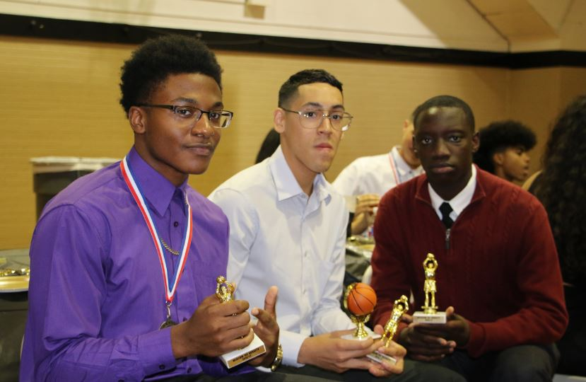 Varsity+Basketball+players+receive+their+awards+