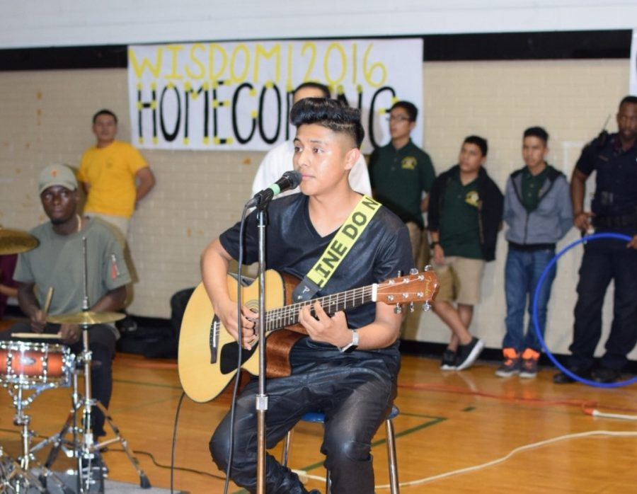 Algua played solo guitar at the Homecoming Pep Rally