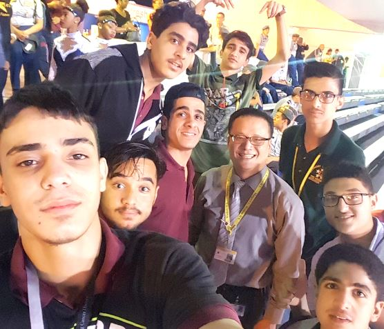Principal Trinh hanging out with Wisdom HS students at the last football game of the season.