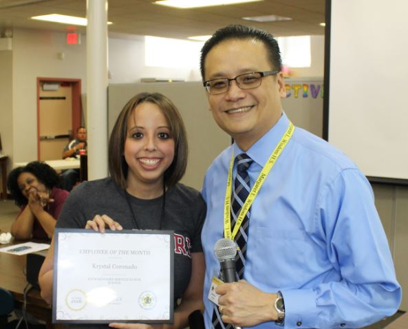 Mrs. Coronado was named the Employee of the Month for November, and given an award by Principal Trinh.