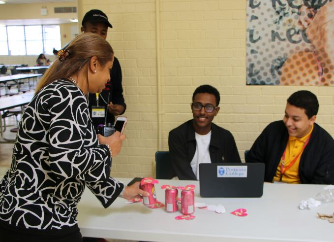 Mrs. Smith-Davis purchases a soda from Interact Club member Michael Negussie
