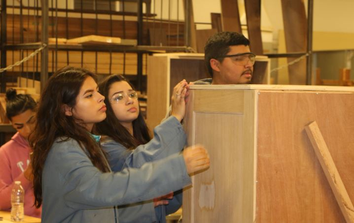 Cindy Garcia and Yizel Real work on a project in Woodmaking class.