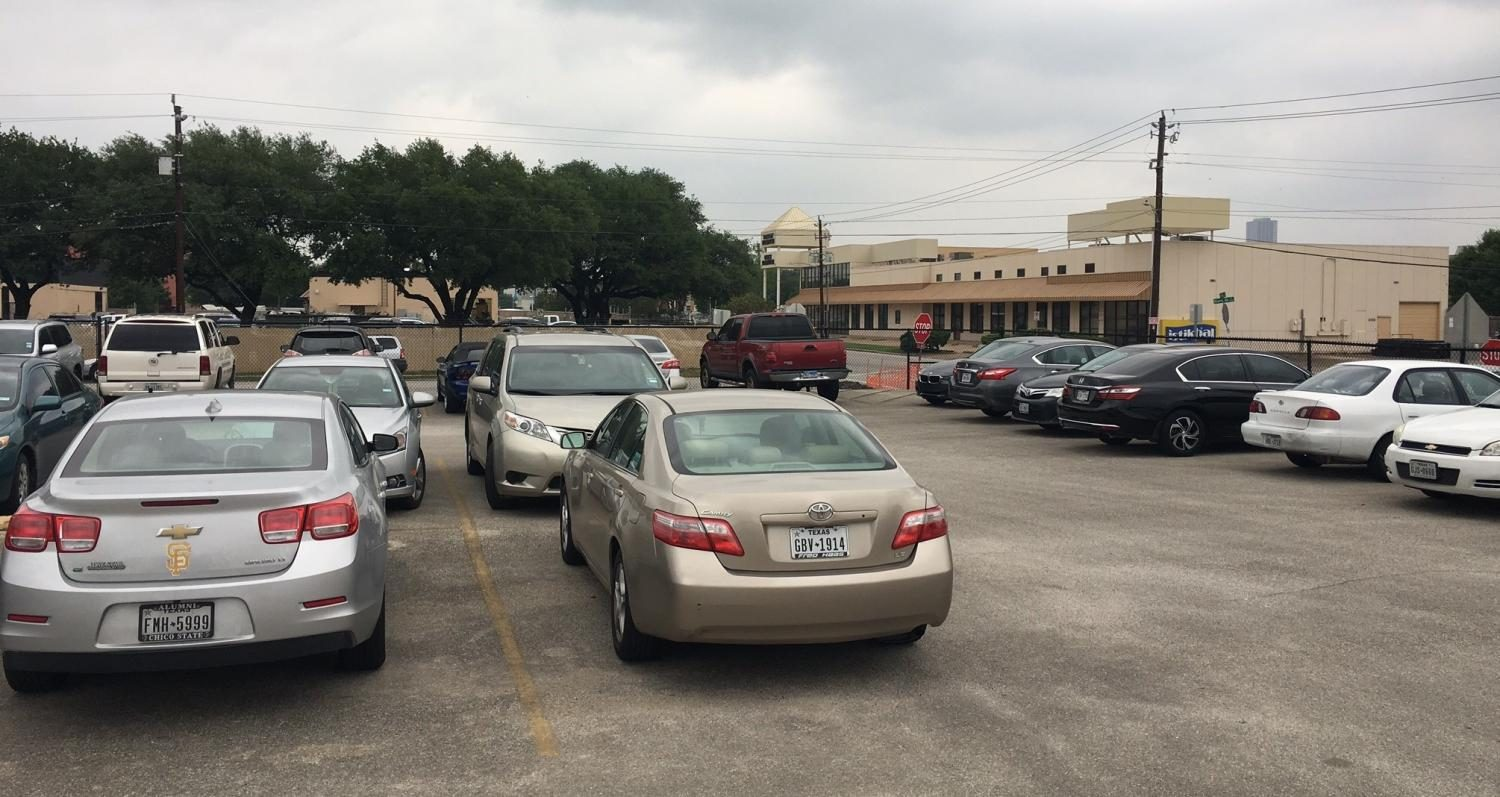 The staff parking lot is over-crowded due to people who double-park. The buses are having a hard time making the turn to pick up students.