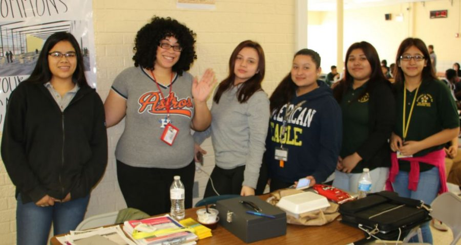 Mrs. Witter and some students holding a fundraiser during Spirit Week