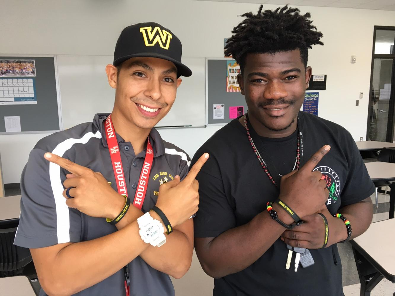 Coach Perez and Senior Defensive Lineman Chris Basilobo show off the football team's inspirational wrist bands that are for sale for $3.00