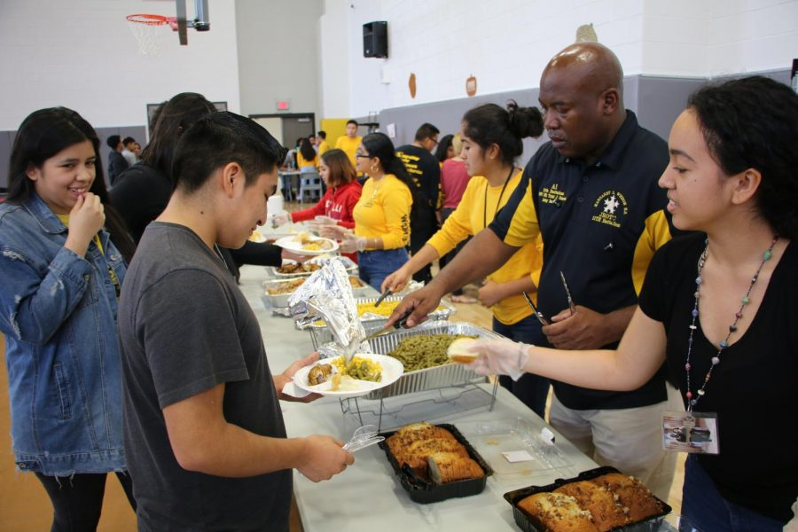 Sgt. Conrod fills a plate of food for a Wisdom Cadet