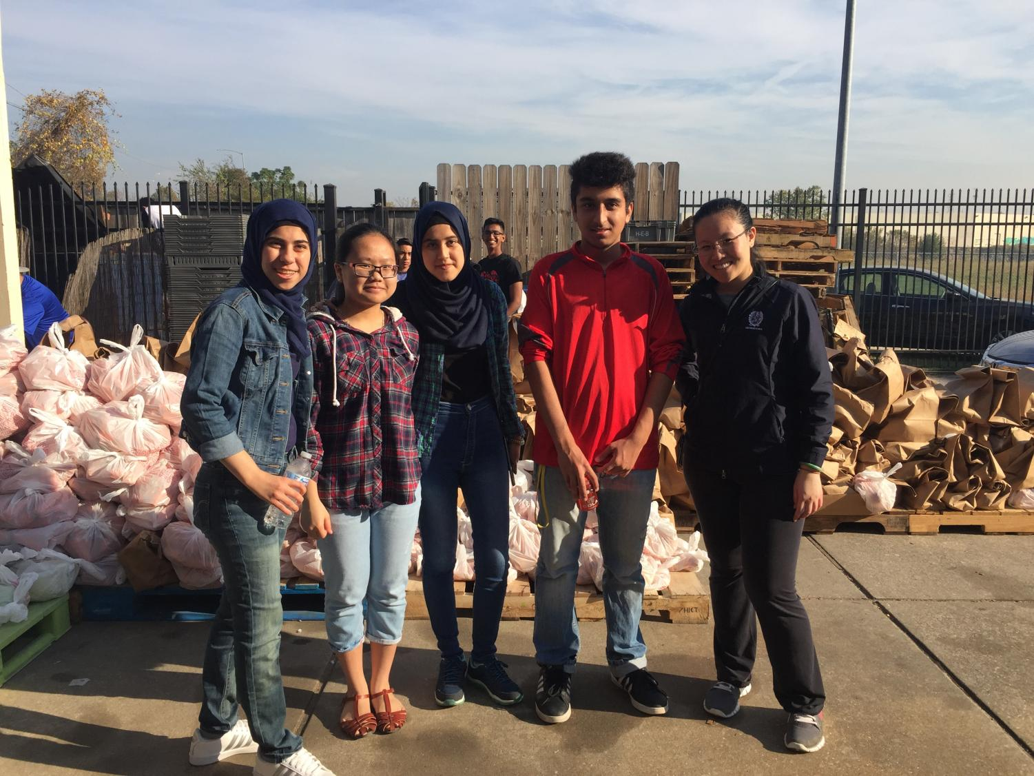 Members of the WHS Key Club volunteering at a local food pantry