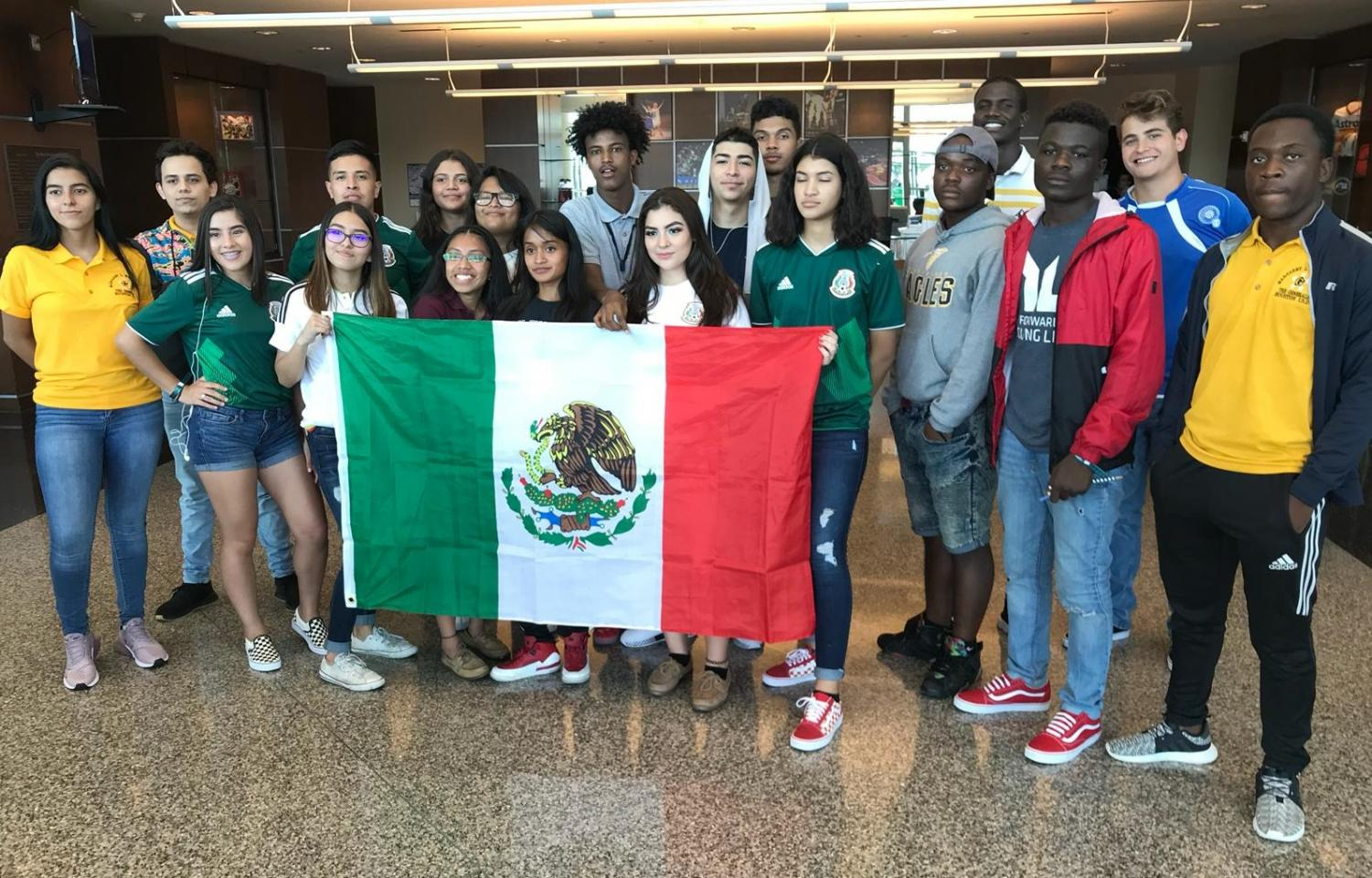 Houston ISD students hold up the flag of Mexico prior to the soccer match at NRG Stadium; Friday, Sept. 7, 2018.
