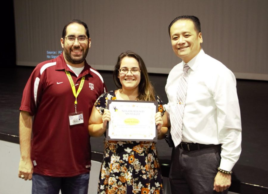 Assistant Principal Romulo Ramos issues a Spotlight Teacher of the Month Award to Isuey Iraheta