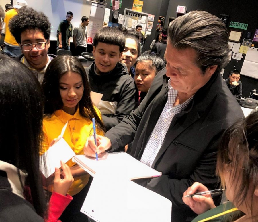 Padilla signed autographs for Wisdom students after he spoke to the class.