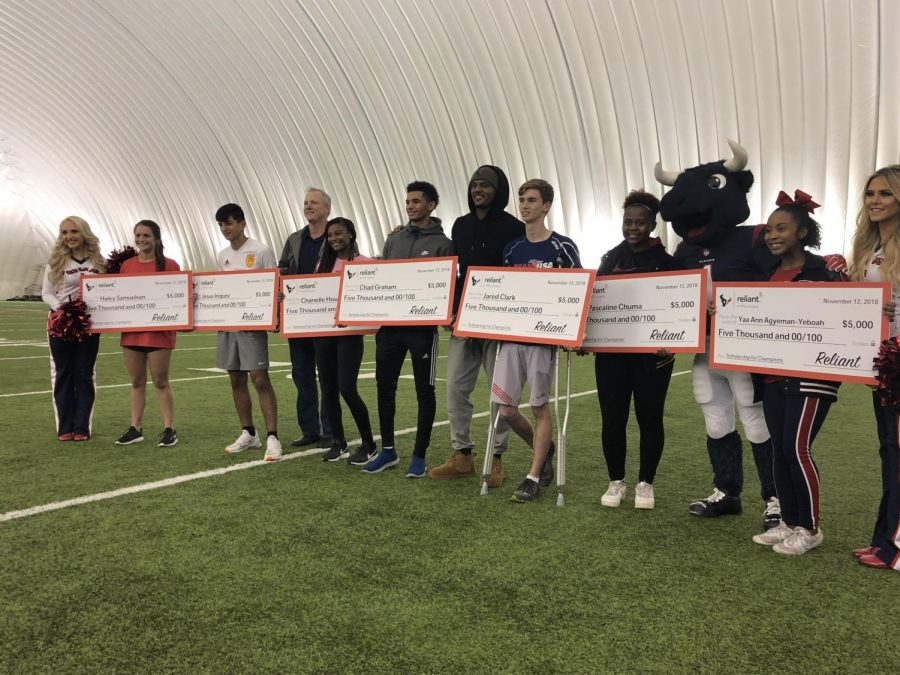 Wisdom Senior student-athlete Pasculine Chuma (next to the Bull) was one of eight scholarship winners presented by NRG and Reliant Energy. Texans QB Deshaun Watson was on hand at the ceremony held at the Houston Methodist Training Center.