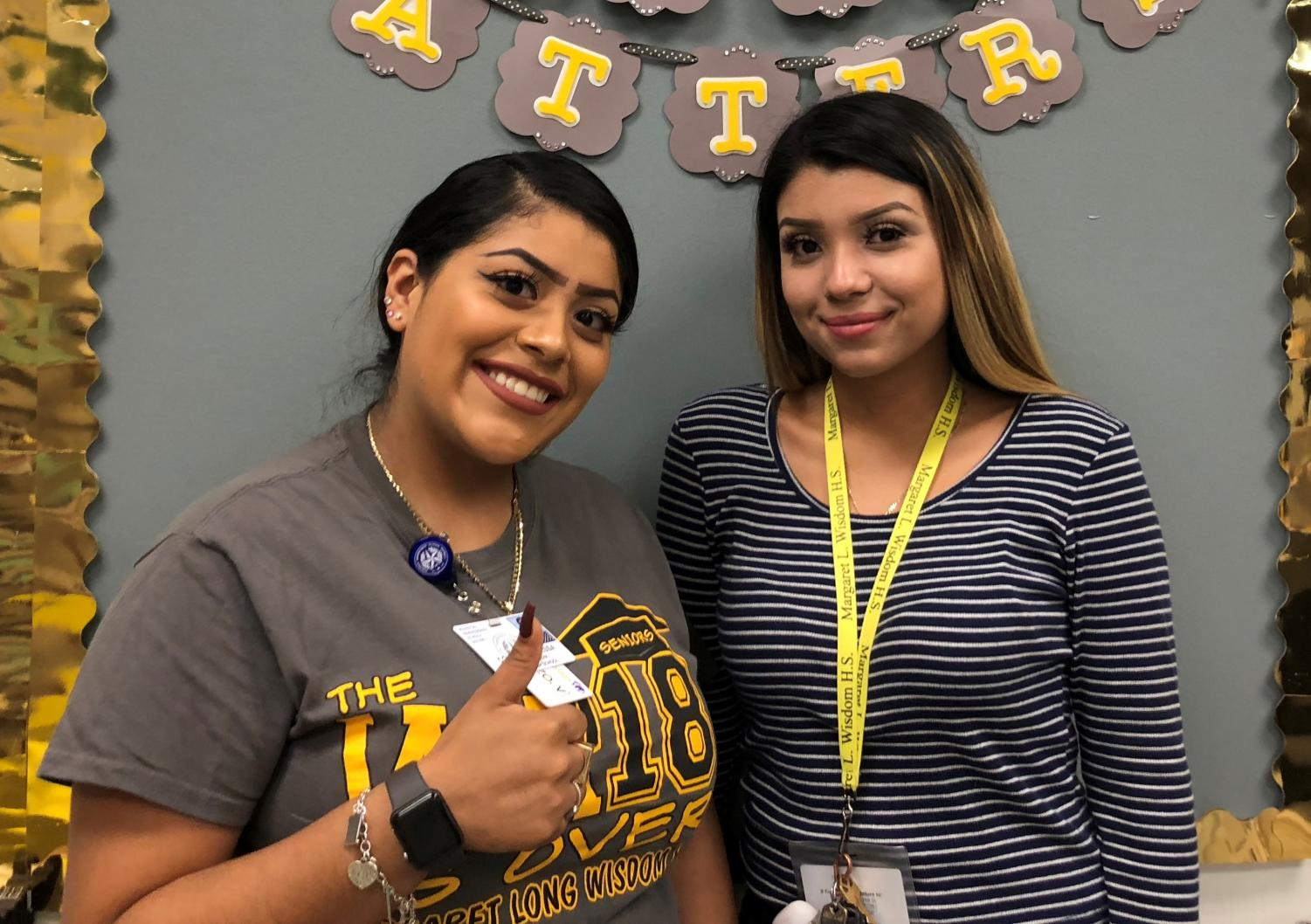 Collazo (left) and Abeja (right) both recently graduated from Wisdom HS and are now working here.