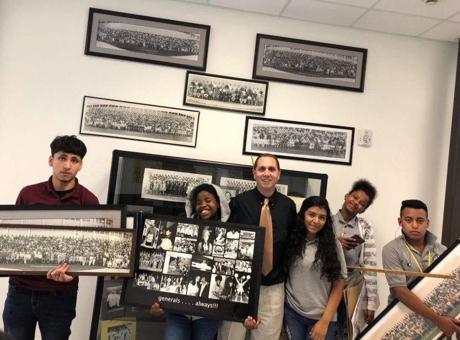 Student+reporters+of+The+Wisdom+Chronicle+in+Mr.+Fanucchi%27s+class+helped+organize+a+project+to+hang+old+class+photos+from+the+history+of+Lee+High+School+%281963-2016%29+in+the+main+hallway+of+the+new+Wisdom+HS.