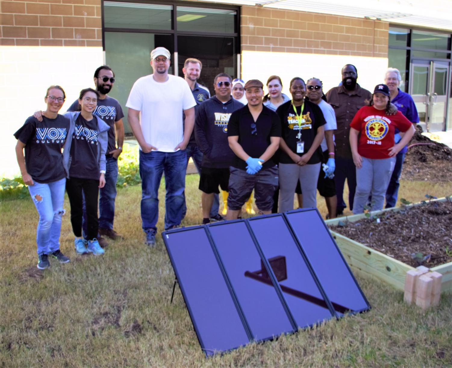 A group of volunteers that helped install a solar-powered garden at Wisdom HS; Saturday, December 1, 2018.