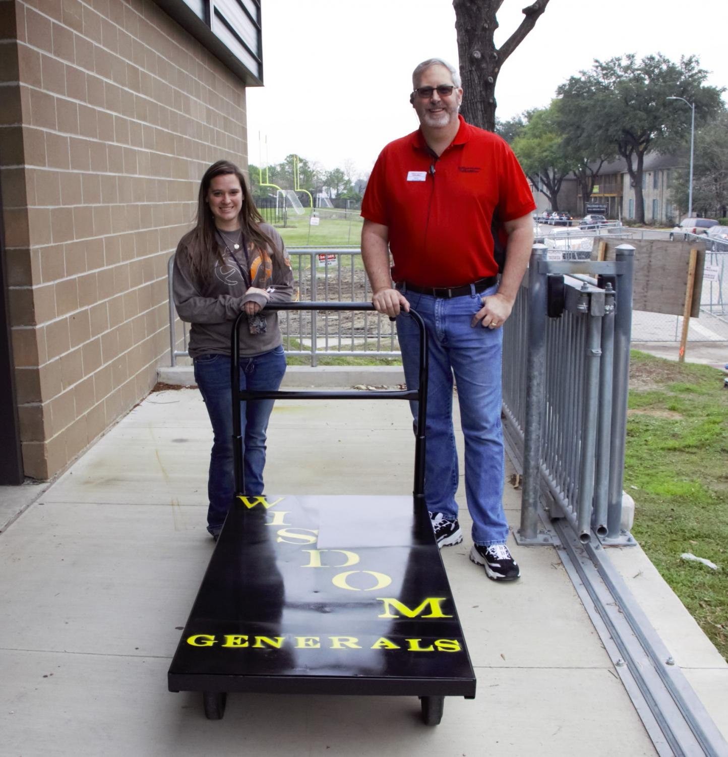 Wisdom Welding Instructor Brittney Morrison and Office Depot General Manager Mark Palmer; with the bulk load cart that the Generals repaired.