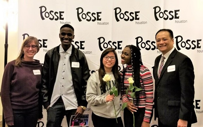 Fabian-Dubon & Irafasha (holding flowers) after hearing they were named Posse Scholars. Wisdom Principal Jonathan Trinh (right).