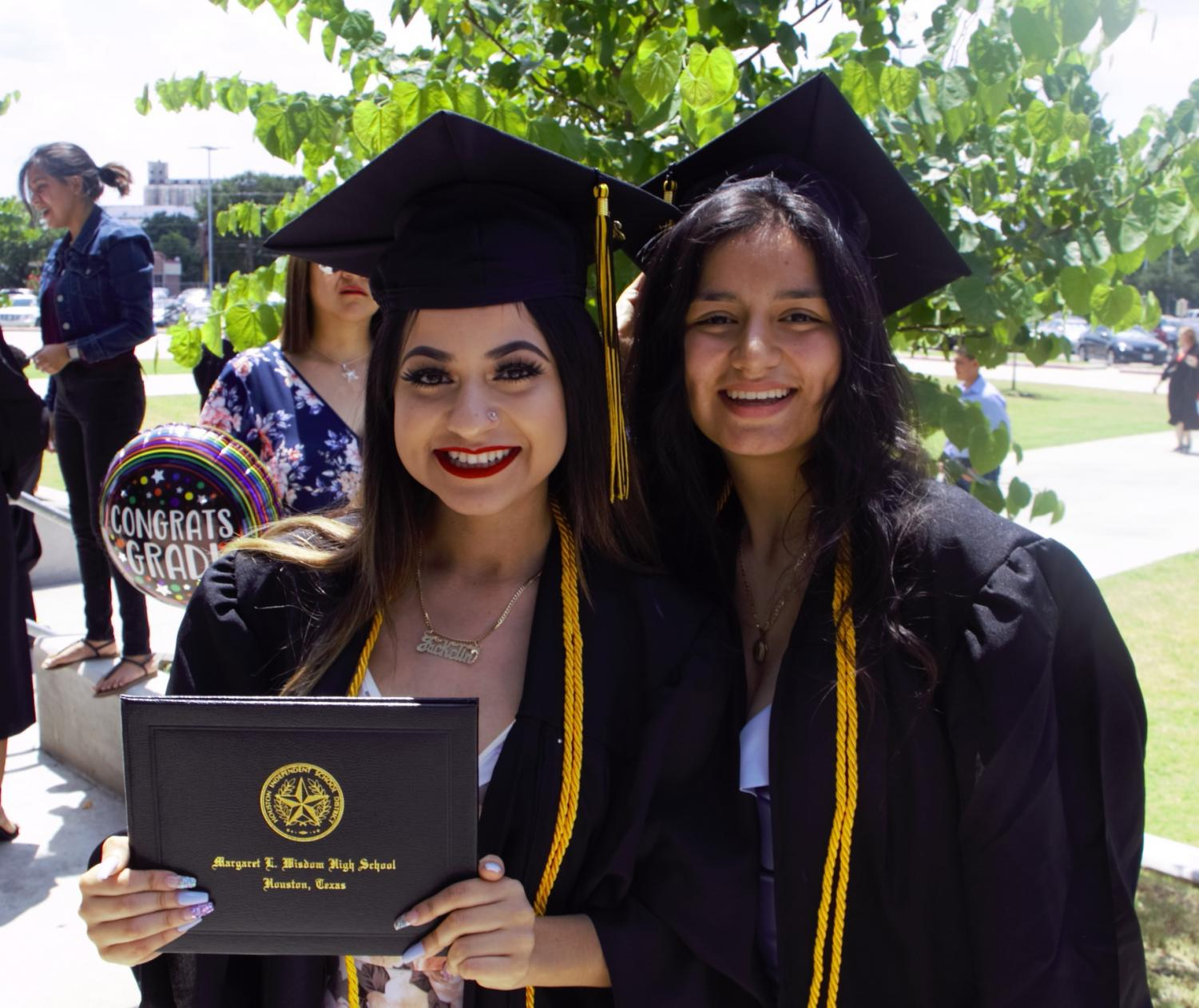 Jackeline Garcia & Cristina Garcia Alvarez are all smiles after receiving their diplomas at the Wisdom HS Class of 2019 Graduation Ceremony