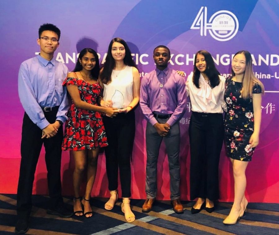 Hassan (white shirt; third from left) was part of a team of students that won the Entrepreneurship competition at this summers Rice Univ. Youth Leadership Summit.