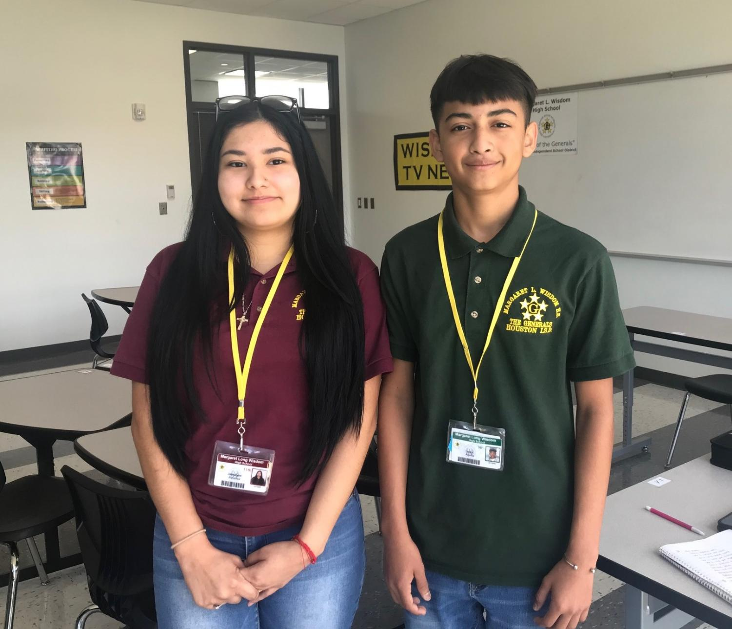Two Wisdom students are shown with the proper dress code and also wearing their student ID's.