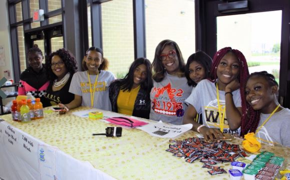 The PEARLS Club at their fundraiser selling sweets & candy