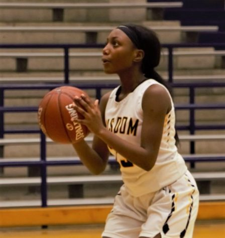 Wisdom Senior Shadia Mutoni shoots from the free throw line