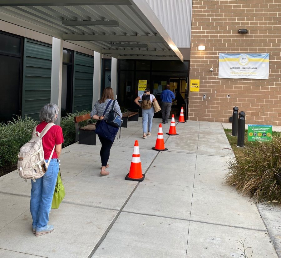 Teachers arriving at Wisdom HS must have their temperature checked and be screened before entering the building. HISD is also requiring all employees to check in on a phone app by 7 am each day.
