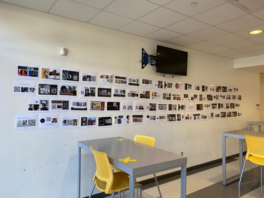 A wall at Wisdom HS that has photos and QR Codes for students to scan with their phones, to read about important figures and events, during Black History Month